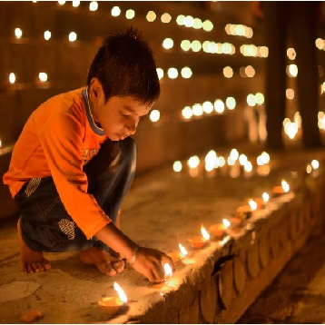 Dev Diwali Offering Earthen Lamps in Varanasi