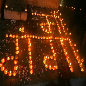Ma Ganga written with Earthen Lamps in Varanasi