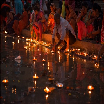 Offering Earthen Lamp in River Ganga Dev Diwali Varanasi